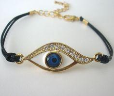 gold bracelet, evil eye bracelet, good luck bracelet, blue evil eye bracelet, Kabbalah bracelet wrist. $17.99, via Etsy.