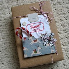 A little busy for my taste, but I like the idea of wrapping with craft paper and adding a little pocket for the gift tag and a mini candy cane.