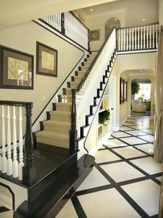 A staircase guides visitors upstairs immediately upon entering the house. Entryway Staircase : Design Line Interiors : Entryways And Halls : Pro Galleries : HGTV Remodels Contemporary Hallway, Painted Staircases, Painted Stairs, White Stairs, Black Staircase, Black Banister, Foyer Decorating, Decorating Ideas, Carpet Stairs