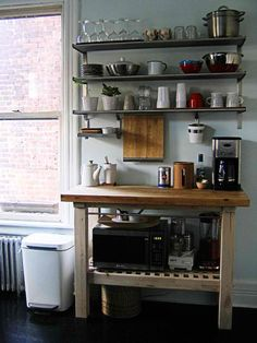 Love these metal shelves for extra kitchen storage!
