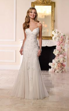 Glamorous. Sexy. Extravagant. This designer wedding dress from Stella York features glistening Diamante beading on pretty lace over Lavish satin.