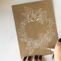 Something new for me - floral line drawings. How lovely is white on kraft paper? . . Materials used:  @micadorforartists kraft paper  @uniball_uk signo pen  @sallyhansenau color therapy nail polish - 'slicks & stones' . . . #marlenemakes #process_of_creativity #hyperlapse #timelapse #floralwreath #micadorforartists #kraftpaper #uniballsigno #floralillustration #linedrawing