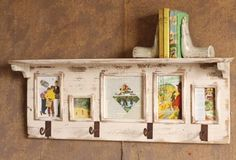 rustic wooden shelf with four hooks and photo holders