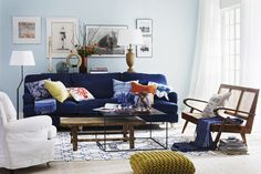 blue sofa, mixed coffee tables - this is fun! @Karen Rogers do you think this coffee table mixing thing is crazy? I kind of like it.