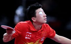 Chinas Ma Long serves to Germanys Timo Boll on May 19, 2013 in Paris, during the quater finals of the Mens Singles of the World Table Tennis Championships. JACQUES DEMARTHON/AFP/Getty Images