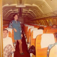 """Braniff - coach cabin 727 Braniff Place. """"Open Wide and Say Coach""""."""