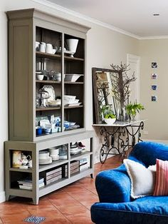 Transforming china hutch. Remove doors, paint inside darker contrast color. Use for storage