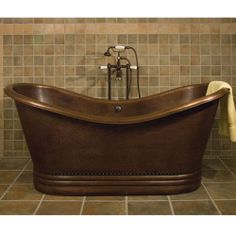 Hammered copper tub, can see the bubble baths now!