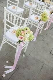 Small posies with trailing satin ribbons make an aisle fit for a princess.