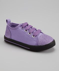 These super-cool sneaks are packed with a playful punch of color and a dash of glitter and sport a reinforced toe cap to fuel endless adventures.Cotton / canvas upperRubber soleImported