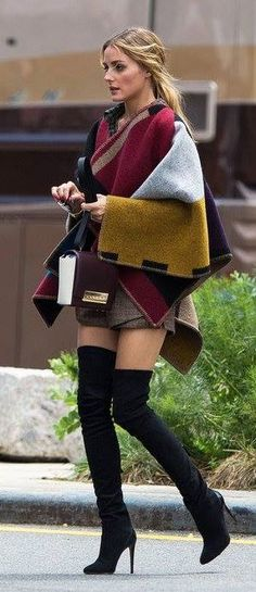 Olivia Palermo in sexy thigh-high boots and an oversize poncho