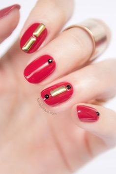 Elegant nail art with studs. Click for more info. #studs #nailart