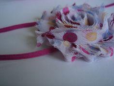 Polka dot chiffon rose elastic headband. $4.50, via Etsy.