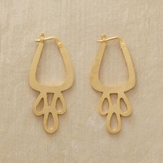 """vvv ICONIC TEARDROP EARRINGS--Resembling iconic tribal art but with a modern slant, our hand-cut hoops gleam with 10kt goldplate. By Jane Diaz Exclusive. 1-1/2""""L."""