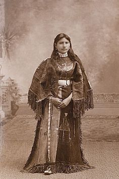 An old photograph of an Arapaho Maiden.
