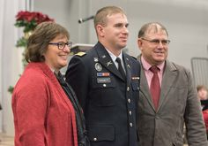 Daniel Hogsett, center, received his commission as a second lieutenant in the U.S. Army during undergraduate commencement Dec. 18, 2015, in the Chicoine Center. He is accompanied by his parents, Rita and David Hogsett, all of Lamar, Nebraska. (Tena L. Cook/Chadron State College)