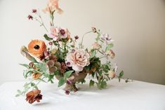 Today's floral arrangement was crafted by Ashley Beyer of Tinge Floral in Salt Lake City who loaded up her studio with all of prettiest blooms in season right now and let her instincts guide the rest. I love the soft pink and orange hues in this arrangement and the winding, wild shapes on display. Ashley's …