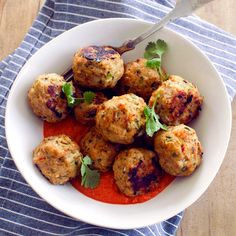 Recipe for savory Thai-Spiced Chicken Meatballs with a Roasted Red Pepper Curry Sauce.