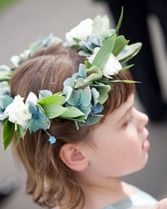these flower girl crowns are thoughtfully designed to capture a rustic elegance. The blue-tinged leaves in the crowns pick up the hues of each girl's dress.