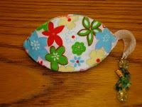 coin purse from plastic container lids.  Three of this shape, cover each with fabric, then stitch the three together.  Forms a pinch purse.