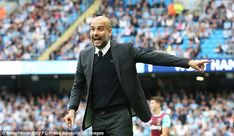 Guardiola gestures to his Manchester City players during their match with West Ham United