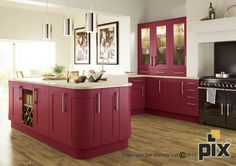 Red painted doors bring personality to the classic shaker CGI kitchen. Curved solid stone worktop and classic rangecooker