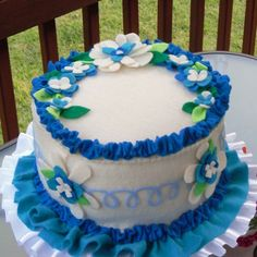 felt birthday cake with multi layer flowers in cobalt and royal blue.