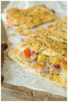 10 puff pastry sheets 1 can tuna (packed in water) 15 green olives 1 small onion 1 small red onion 1 bell pepper 3 tomatoes 1 eggplant 1 1/2 tsp herbes de Provence 1 medium egg salt  pepper 2 tbsp oil Optional: zucchini