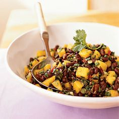 Canned beans are a great option for working protein and fiber into dishes. We tested this mango and black bean salad with organic, no...
