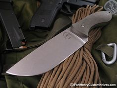 "Maker:  Matt Caldwell,  Handle Material: Linear Textured Green Linen Micarta Blade Steel: N690 Blade Length: 4  7/8″ OAL: 9  5/8"" Sheath: OD Green Kydex Price $245"