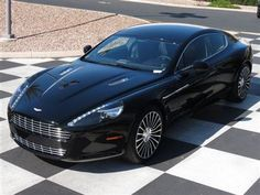 2012 Aston Martin Rapide Sedan in Carbon Black <-inspiration to go to law school & make it big. New Aston Martin, Aston Martin Rapide, Auto Wheels, Automobile Companies, Carbon Black, Law School, Sport Cars, Exotic Cars, Supercars