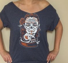 Ships to the U.S. only. Day of the Dead Girl off the shoulder t-shirt. This shirt has been cut at the sleeves, bottom and neck to give that