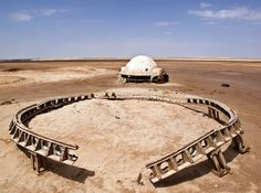 """Italian photographer Rä di Martino took these amazing pictures of abandoned Star Wars film sets in Tunisia. Using Google Earth, she effectively tracked down decades-old locations such as Luke Skywalker's Tatooine dome home, the Lars Homestead, for a number of photographic projects. As she observed on her website, """"Some of it have now become ruins, [...]"""