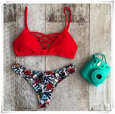 Own it, ladies. The Cross Lattic Bikini Top is red and features criss cross lattice design,and structured bust cups. Fully lined, back S-hook closure. Perfect with Floral Bikini Bottoms, or mixed up with anything you're feeling.