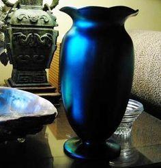I bet this is stunning in person.  Carder-Steuben, Art Nouveau Blue Aurene, Large-Unique Fluted Vase -1936