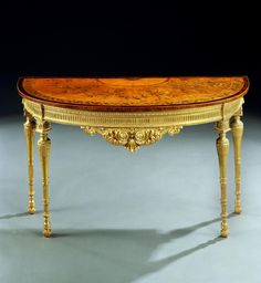 A GEORGE III GILTWOOD AND INLAID SATINWOOD SIDE TABLE - circa 1780