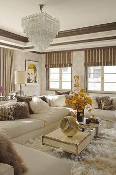 Neutral hues become vibrant when styled with fur throw pillows and a matching rug.   - HarpersBAZAAR.com