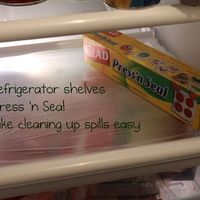 Line refrigerator shelves with Press n' Seal for easy clean up!