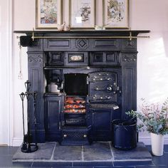 Victorian range in country kitchen    Cast from an original by The Yorkshire Range Company, this reproduction Victorian range cooker is great for making bread and puddings while adding authenticity to a country-style kitchen. Black slate floor tiles from Amtico complement the rustic look.