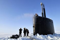 ARCTIC OCEAN (March 21, 2009) Members of the Applied Physics Laboratory Ice Station clear ice from the hatch of the Los Angeles-class submarine USS Annapolis (SSN 760) after the sub broke through the ice while participating in Ice Exercise 2009 in the Arctic Ocean. Annapolis and the Los Angeles-class attack submarine USS Helena (SSN 725) are participating in ICEX to operate and train in the challenging and unique environment that characterizes the Arctic region.