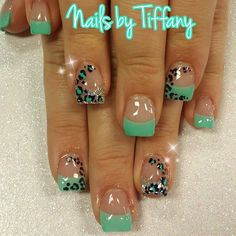 love the cheetah print...over the french tips ↨