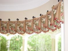 Cuffed valance on medallions with tassel fringe secured with simple furniture knobs - so pretty! Corner Window Treatments, Custom Window Treatments, Window Coverings, Curtain Patterns, Curtain Designs, Curtain Ideas, Drapery Ideas, Bay Window Curtains, Drapes Curtains