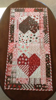 Valentine table runner by Janet Beyea, made from 5 inch charm squares