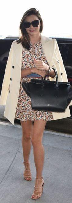Miranda Kerr: Sunglasses – Celine  Coat – Marni  Sunglasses – Chanel  Bracelet – Swarovski  Shoes – Alexander Wang
