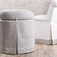 Statement skirts! Stylish seats trimmed with the China Cloud Embroidered Border by Roger Thomas for Samuel and Sons. #detailsmakethedifference #frenchknots #embroidery #ottoman #furniture #upholstery