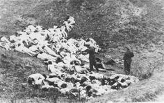 A German policeman shoots individual Jewish women who remain alive in the ravine after a mass execution of Jews from the Mizocz ghetto on October 14, 1942.  Note that a woman has raised herself and turned to look at her executioner.