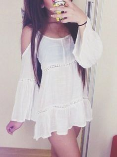 Love this dress. Would be perfect for a musical festival.
