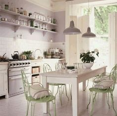 painted metal chairs/open shelving/table in middle of kitchen/pendants(WHITE + GOLD)