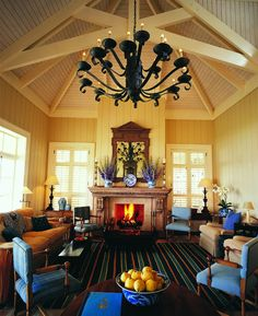 Stylish and cozy by the fireplace at The Lodge at Kauri Cliffs in Matauri Bay, New Zealand.