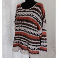 """Hi-Lo Oversized knitted sweater NWOT NWOT Knitted sweater brand new. Feels soft like wool, made of acrylic. Measurements taken flat, back shoulder to bottom 28"""", front is shorter 25.5"""".  Width 26"""" Dainty Hooligan Sweaters Crew & Scoop Necks"""